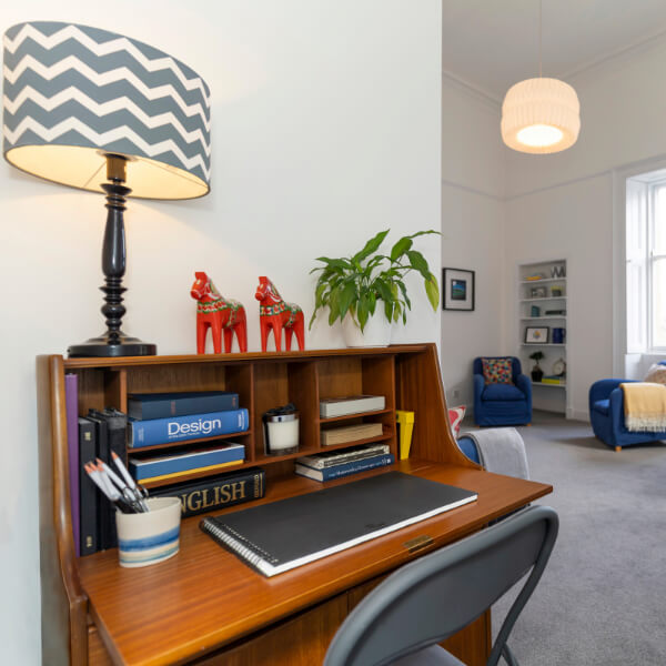 brown desk with lamp